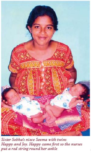 Sister Sobha's niece Seema with twins Happy and Joy.  Happy came first so the nurses put a red string around her ankle