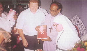 With Bishop Raju, who holds a birthday card from the Queen brought by the Acting British Deputy High Commissioner (left)