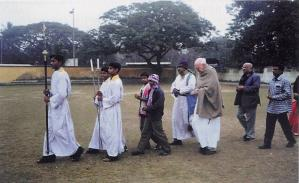 Procession to pray beside Father Mathieson's grave